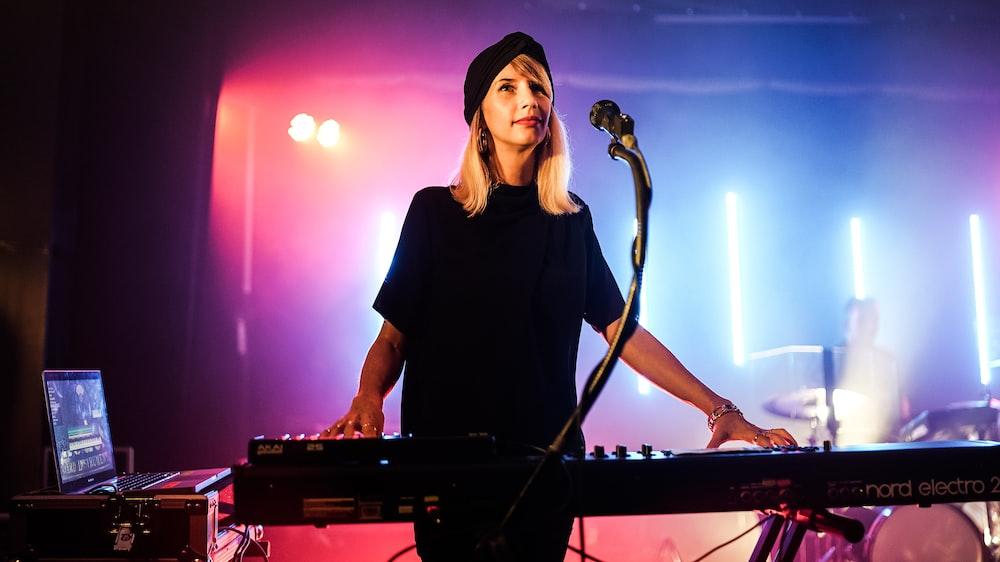 woman plays electronic keyboard