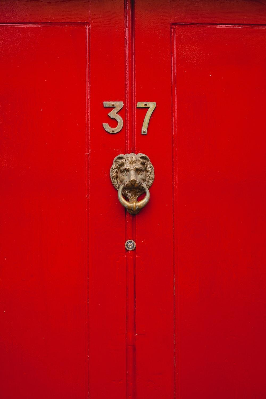 red wooden door with number 37