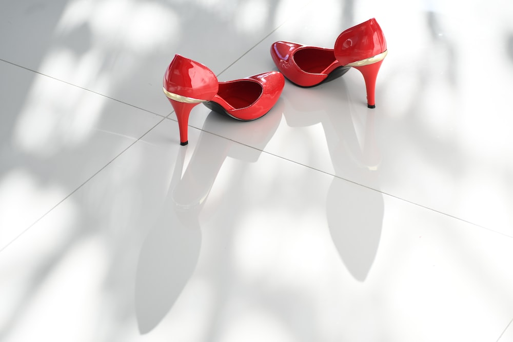 pair of red pump shoes