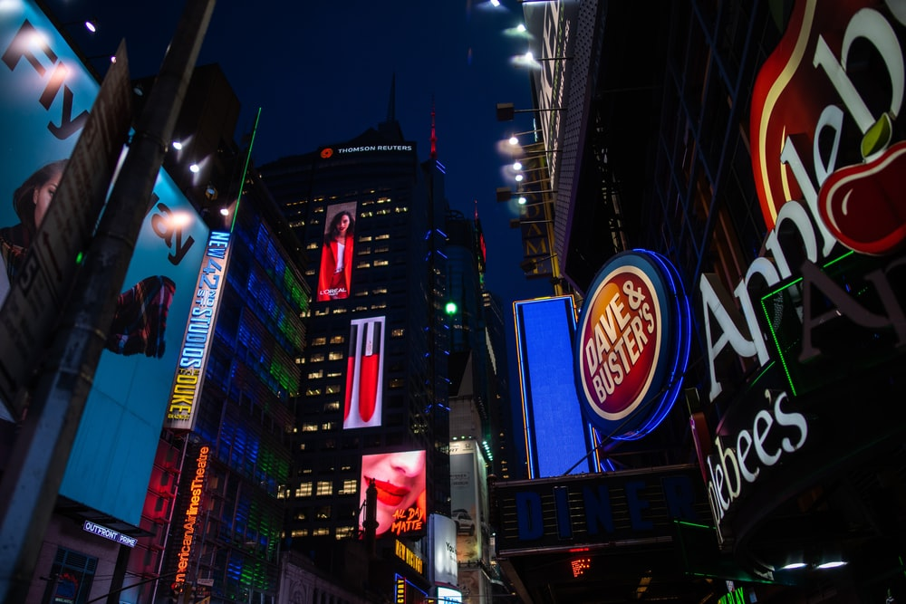 low-angle photography of electric billboards during night