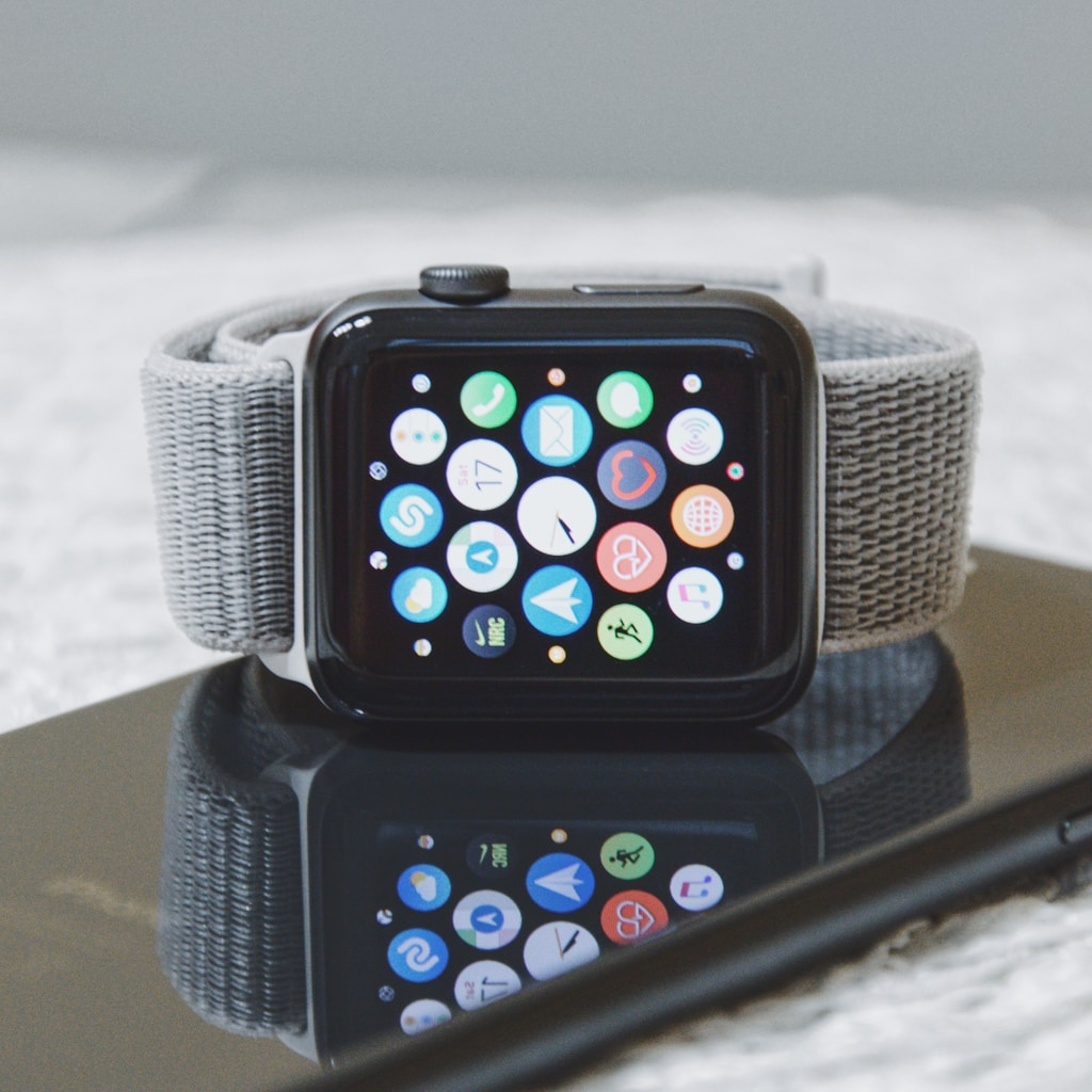 black Apple Watch with gray band on iPhone