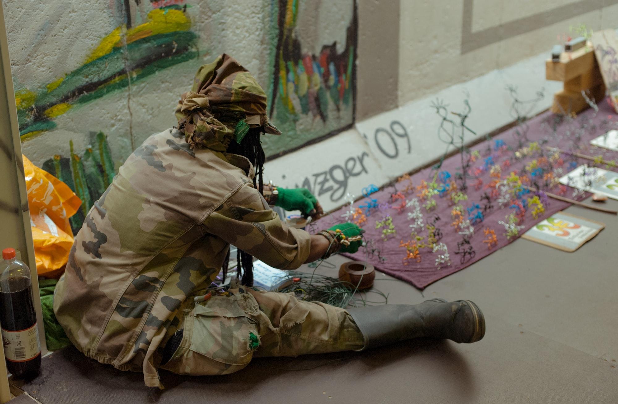 Street artist by Berlin Wall