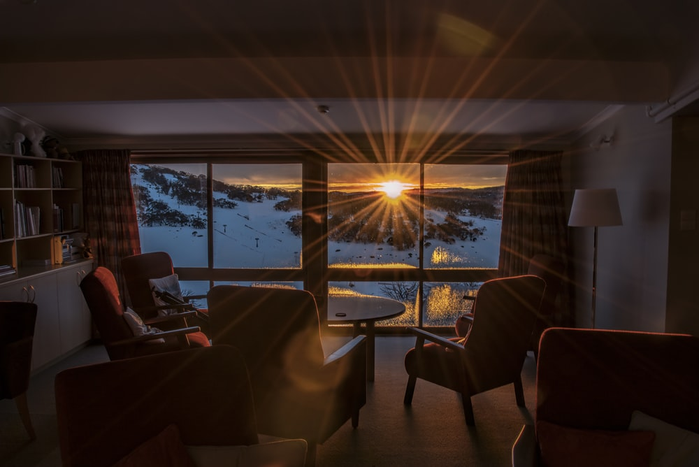 room overlooking a snowy mountain slope