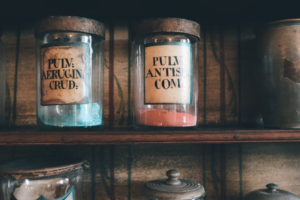 several glass jars on shelf