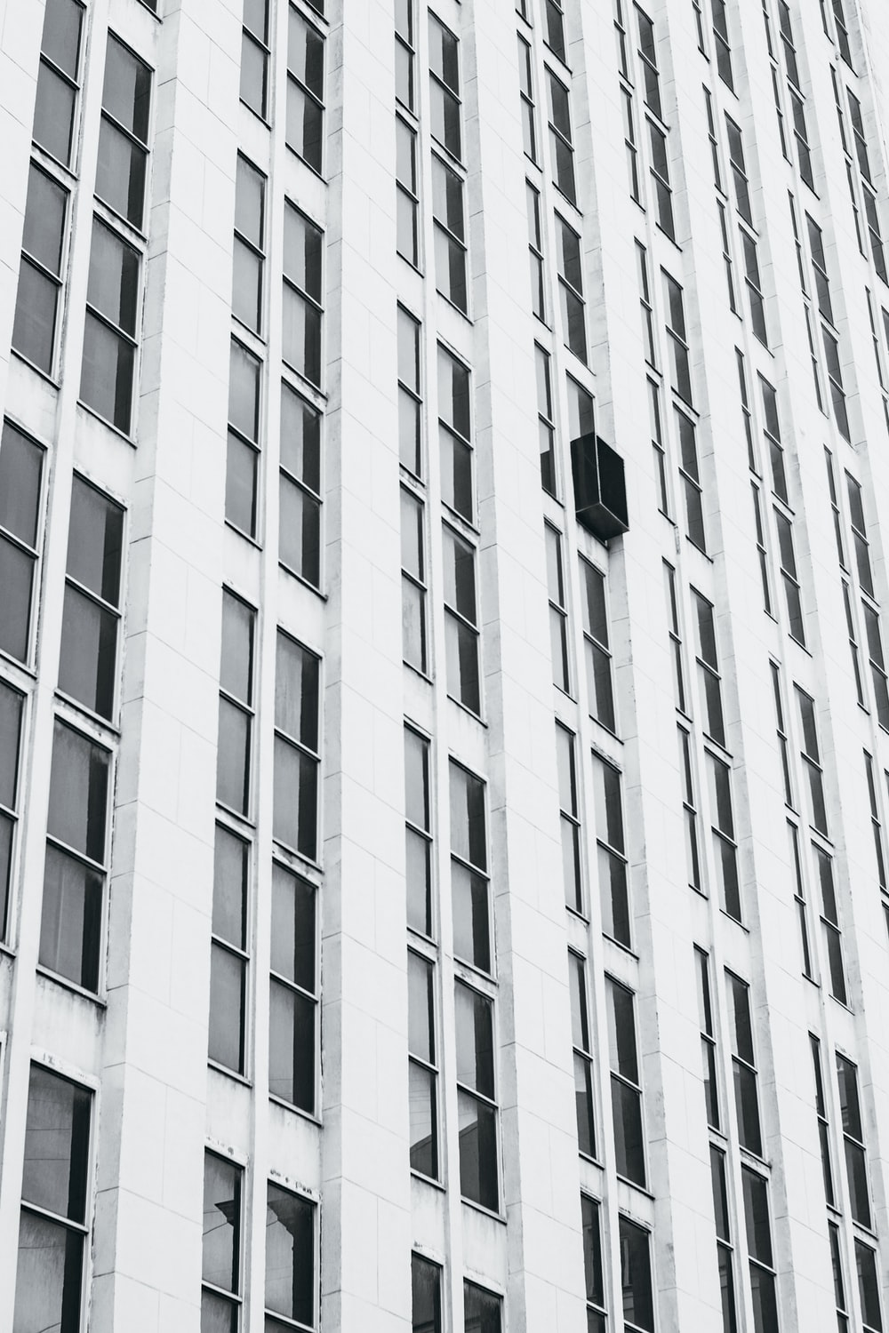 minimalist photography of white high-rise building