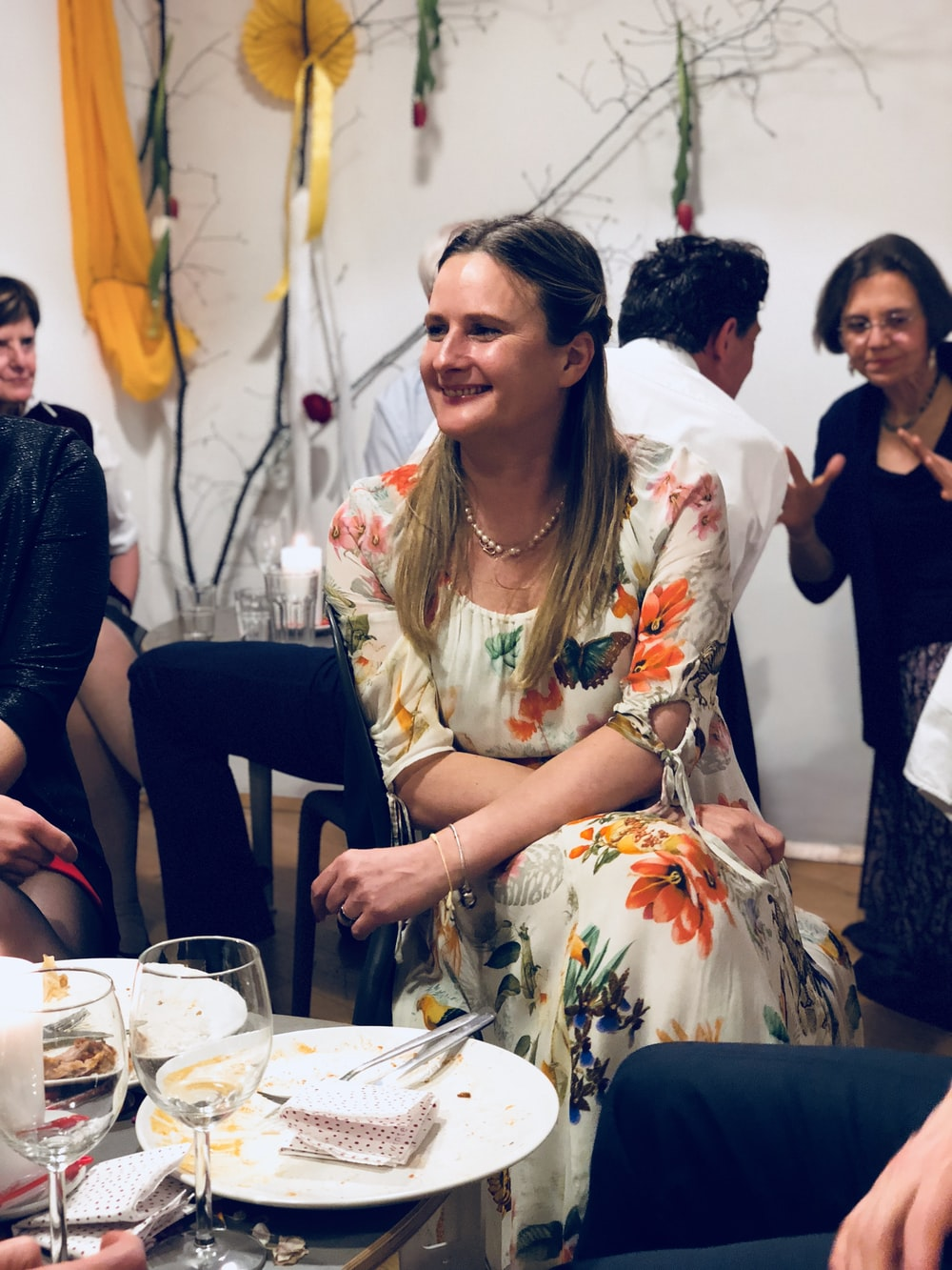 smiling woman sits at the table