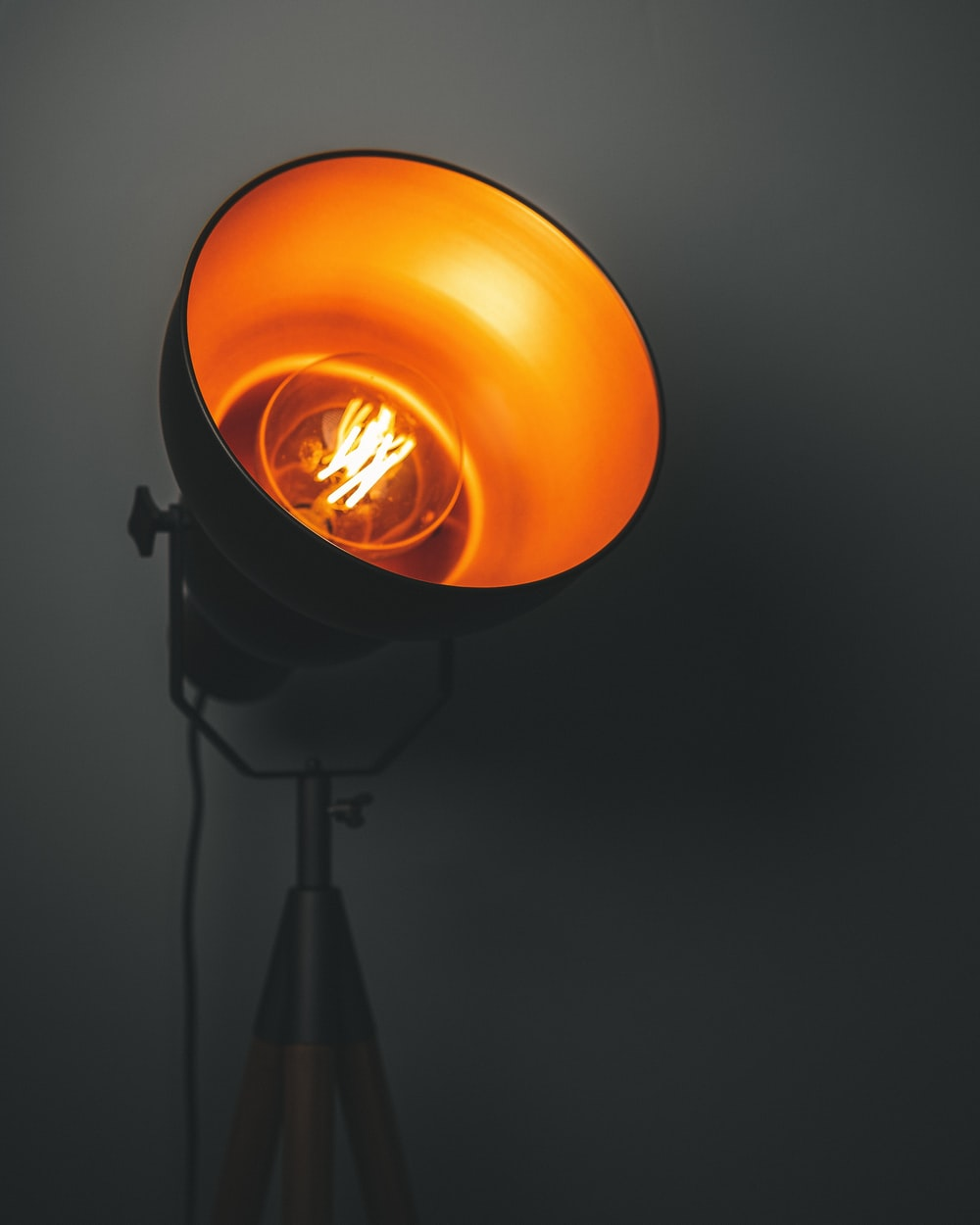 turned-on lamp with tripod