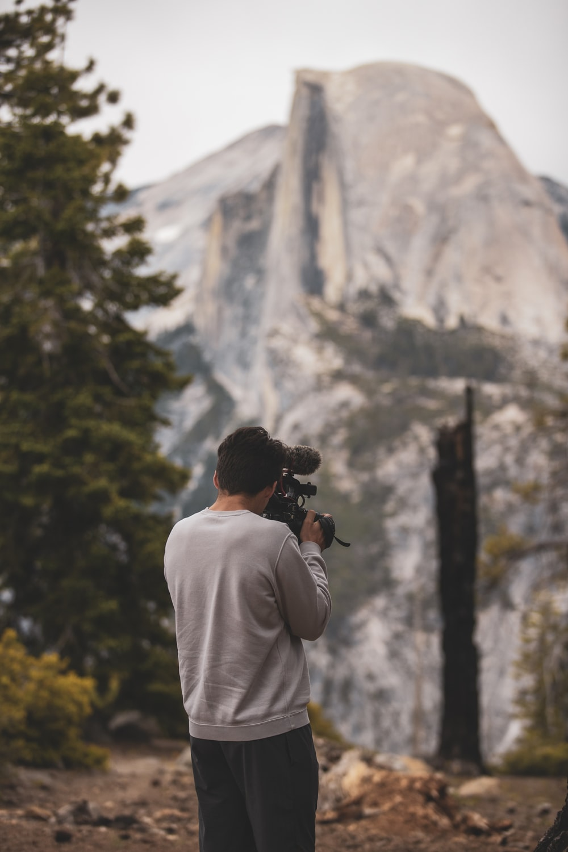 man holding film camera