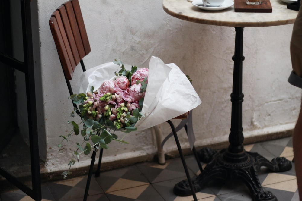 pink rose bouquet on chair