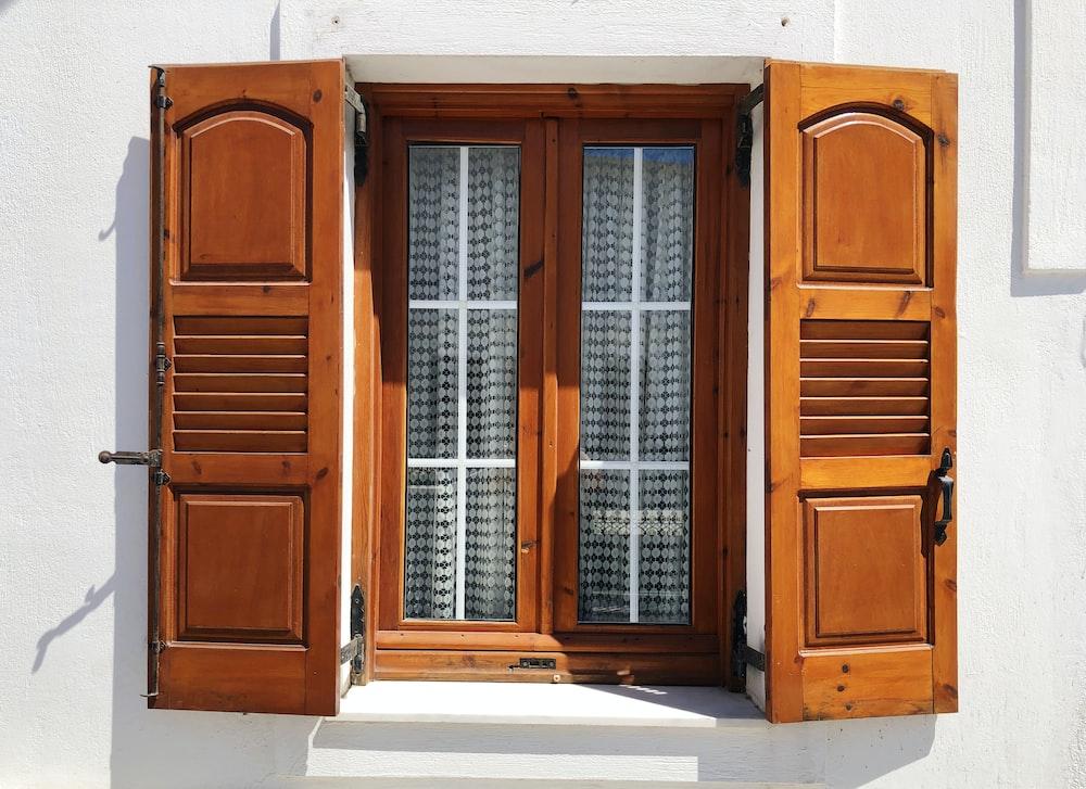 brown wooden window shutter