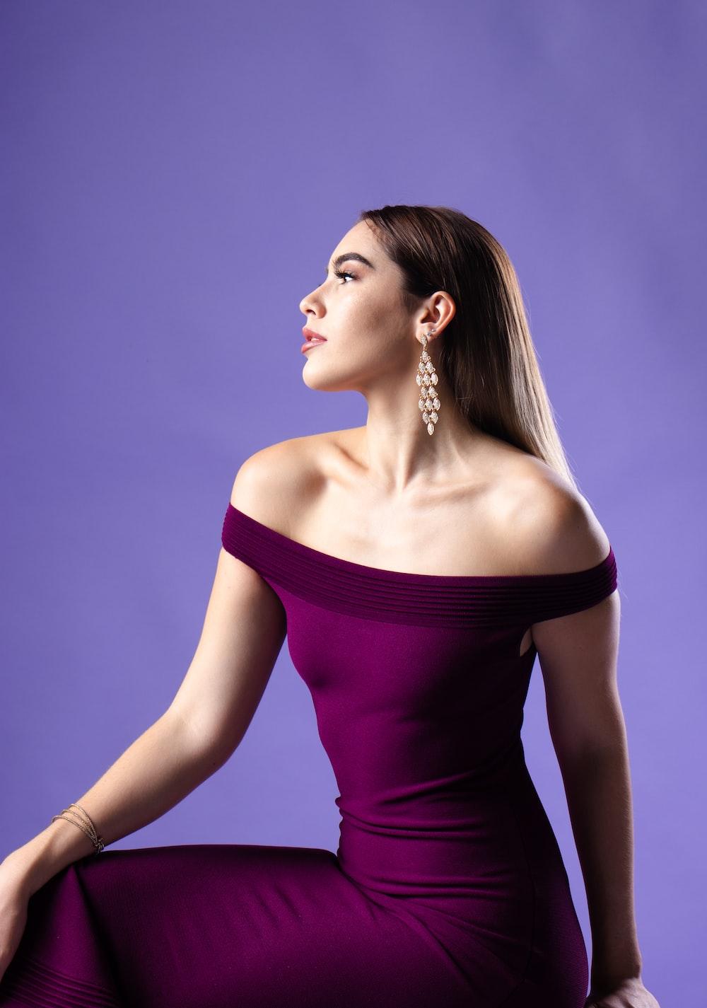 woman wearing purple off-shoulder dress