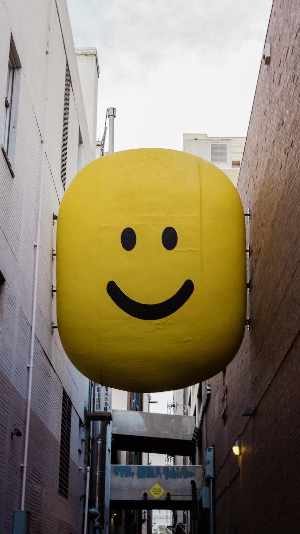 yellow emoji logo