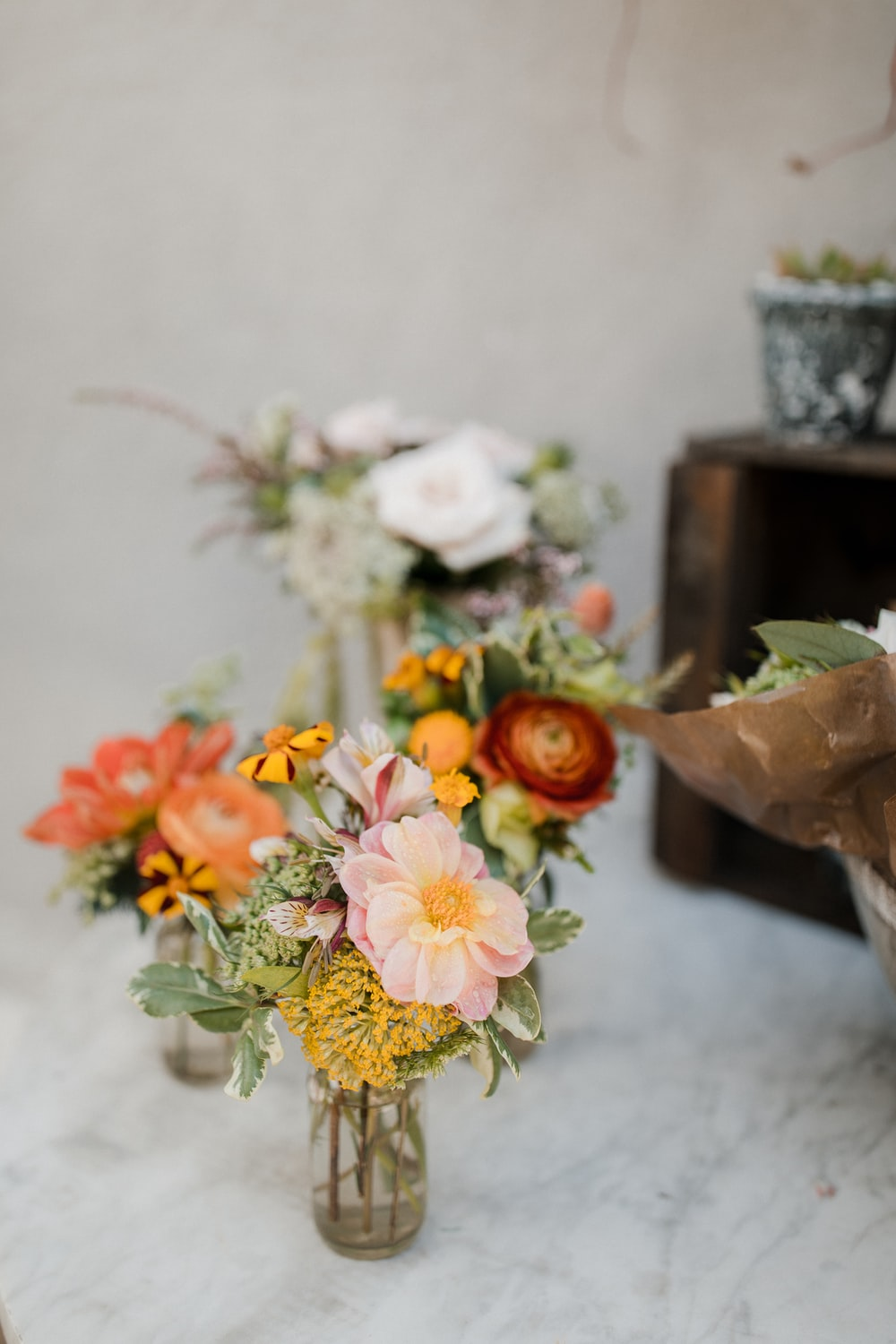 assorted flowers in glass vase