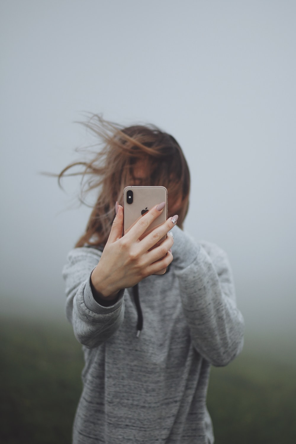 woman holding iPhone smartphone