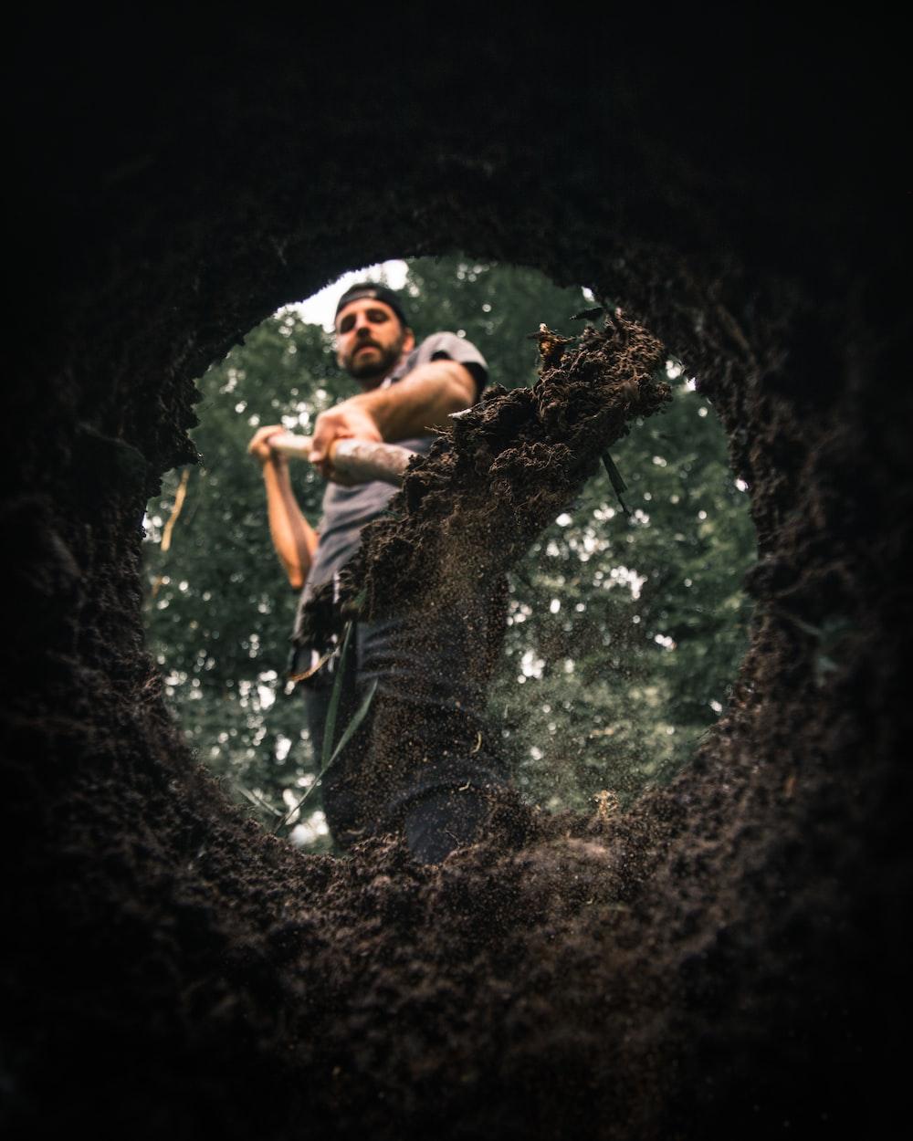 man standing near hole