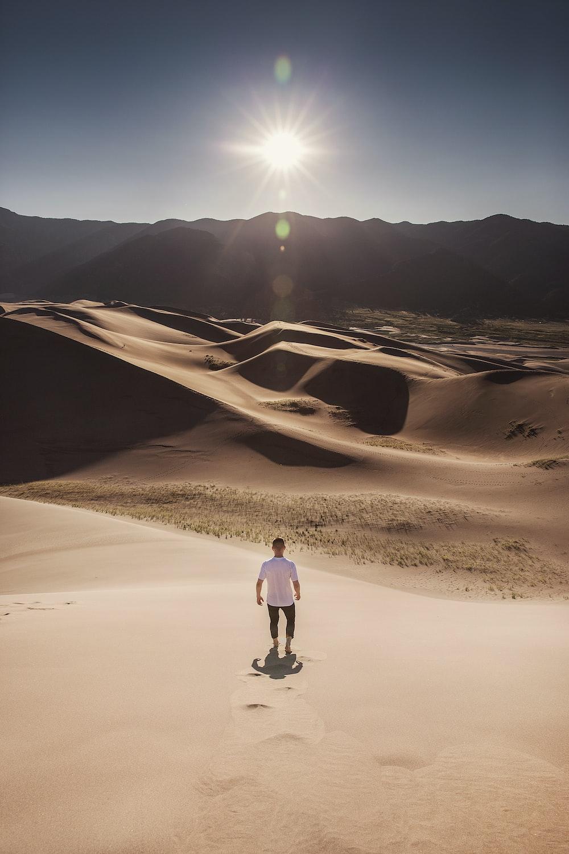 man standing on desert