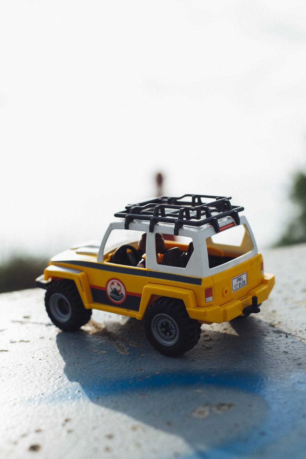 yellow and white vehicle scale model