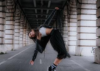 woman dancing between columns