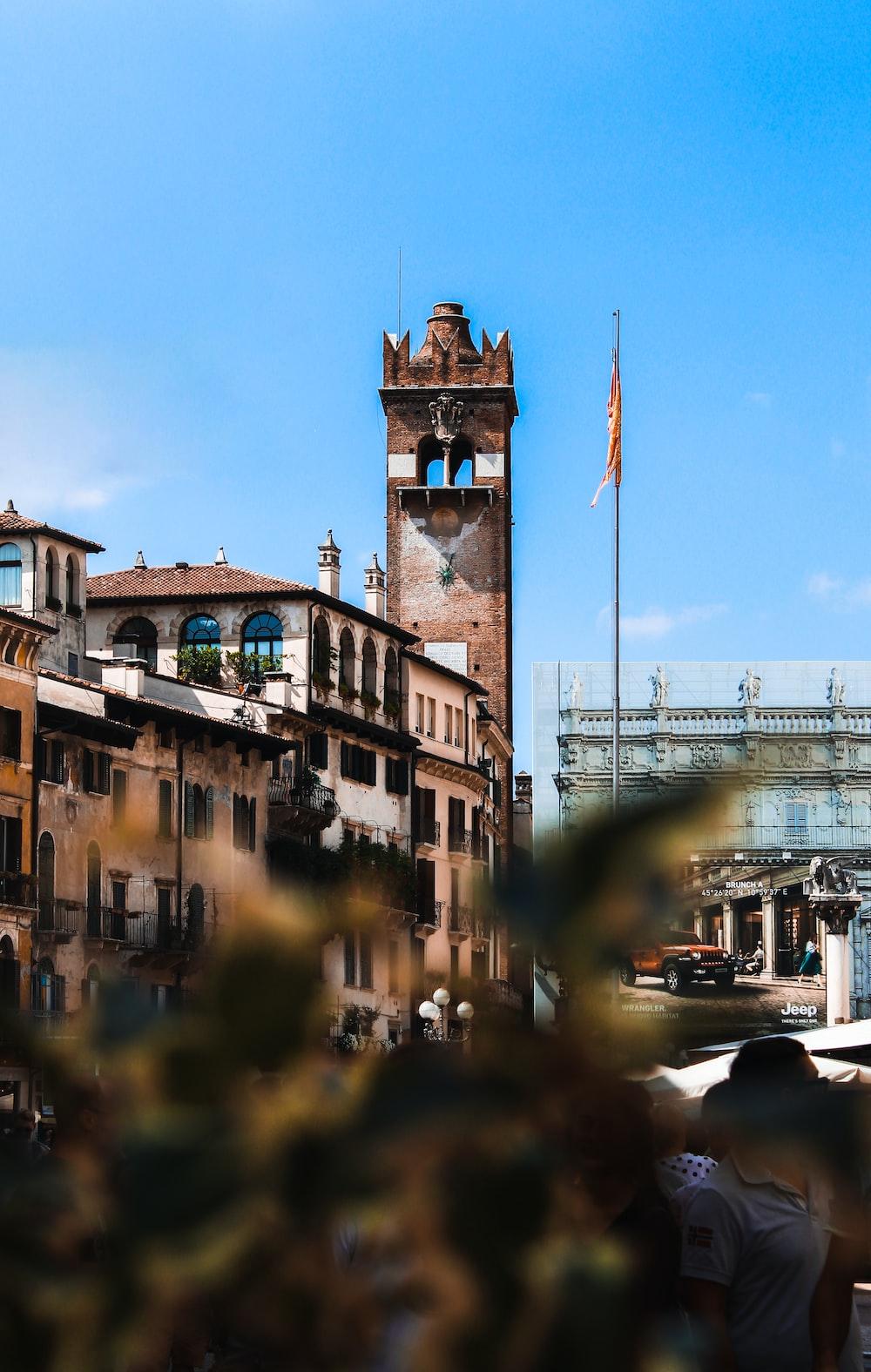 selective photo of brown concrete building