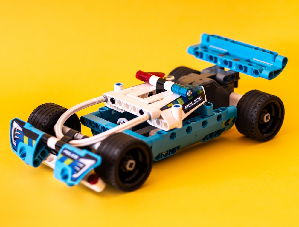 white and blue race car toy