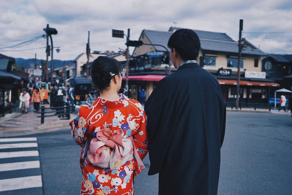 man and woman near pedestrian lane