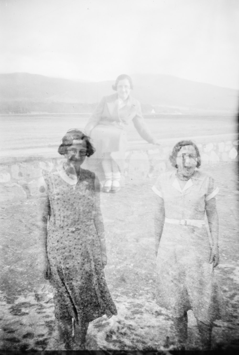 grayscale photo of three women