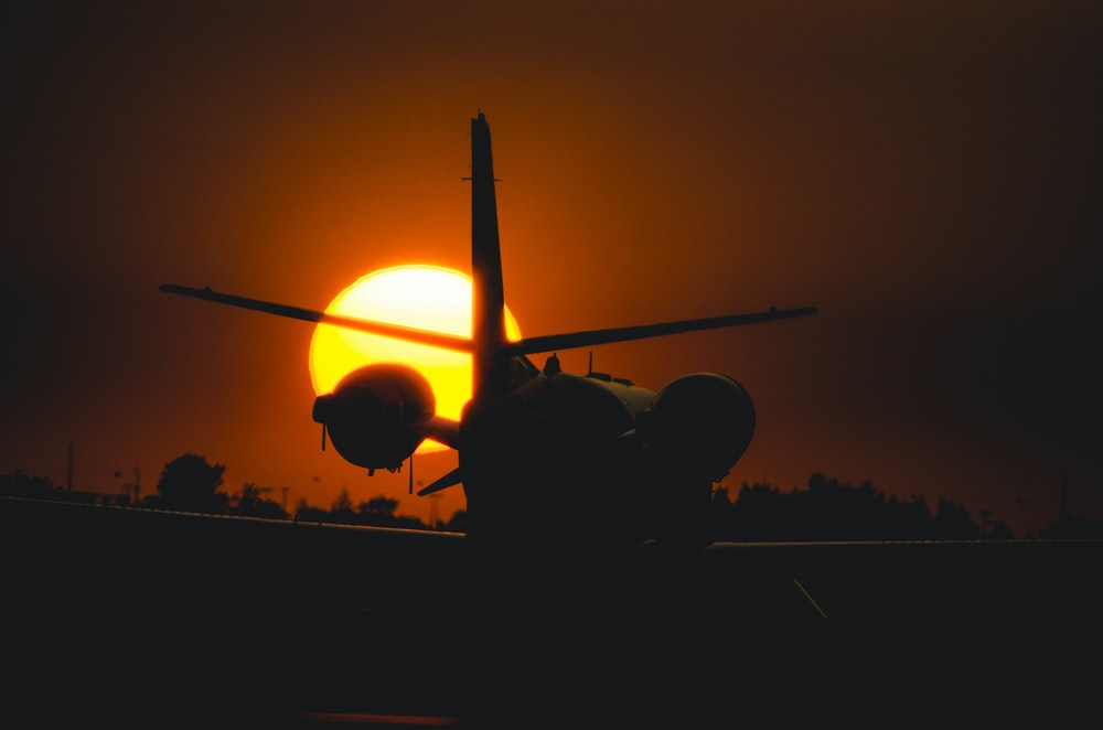 silhouette photo of plane