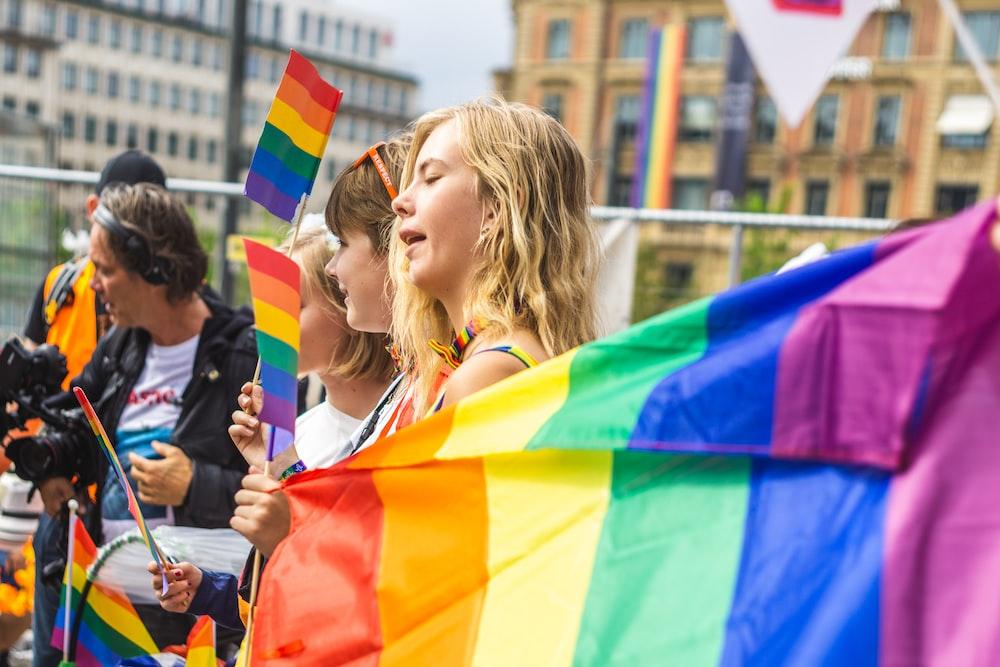 people holding rainbow flags