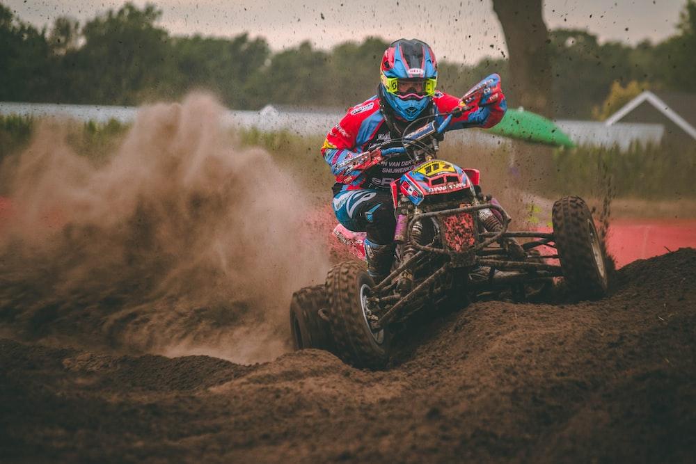 man riding ATV on dirt road