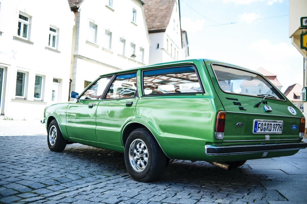 green station wagon parked on street