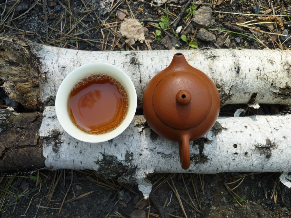 brown teapot and white mug