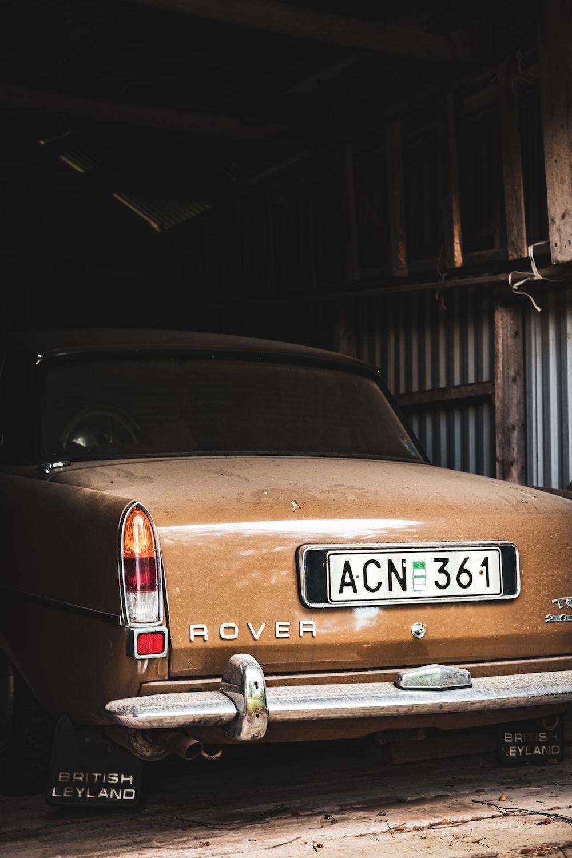 classic brown Range Rover car beside metal wall