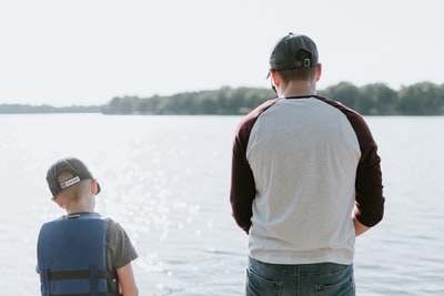 man and boy fishing on water father's day zoom background