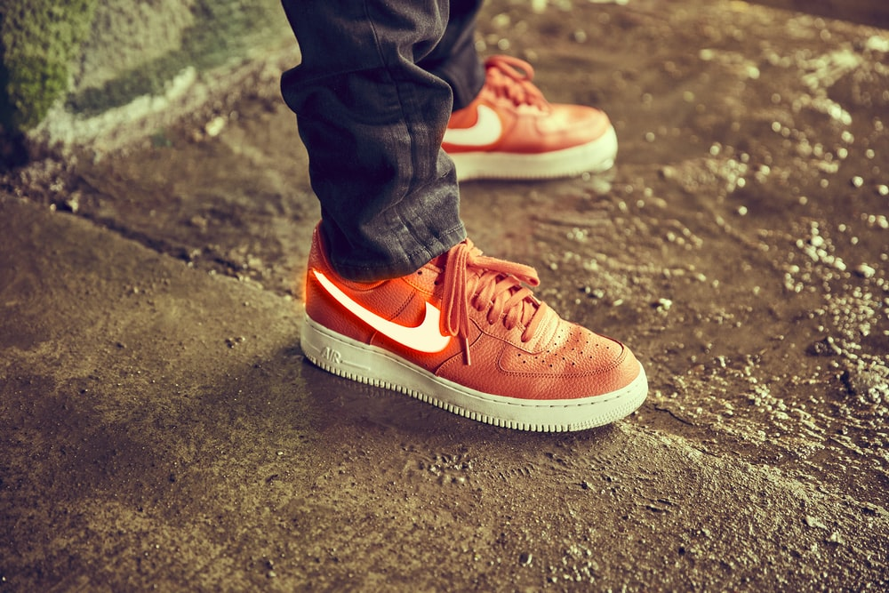 person wearing red Nike shoes