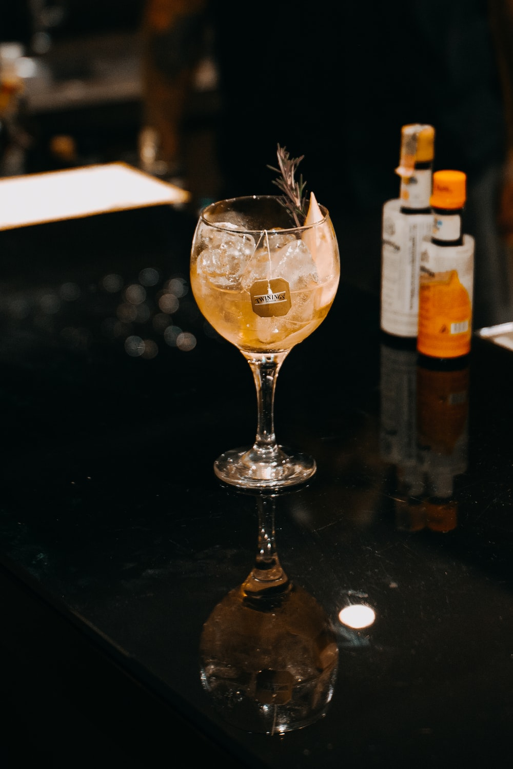 shallow focus photo of clear footed wine glass