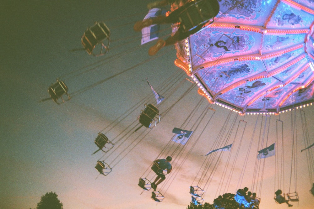 people riding amusement ride during night time