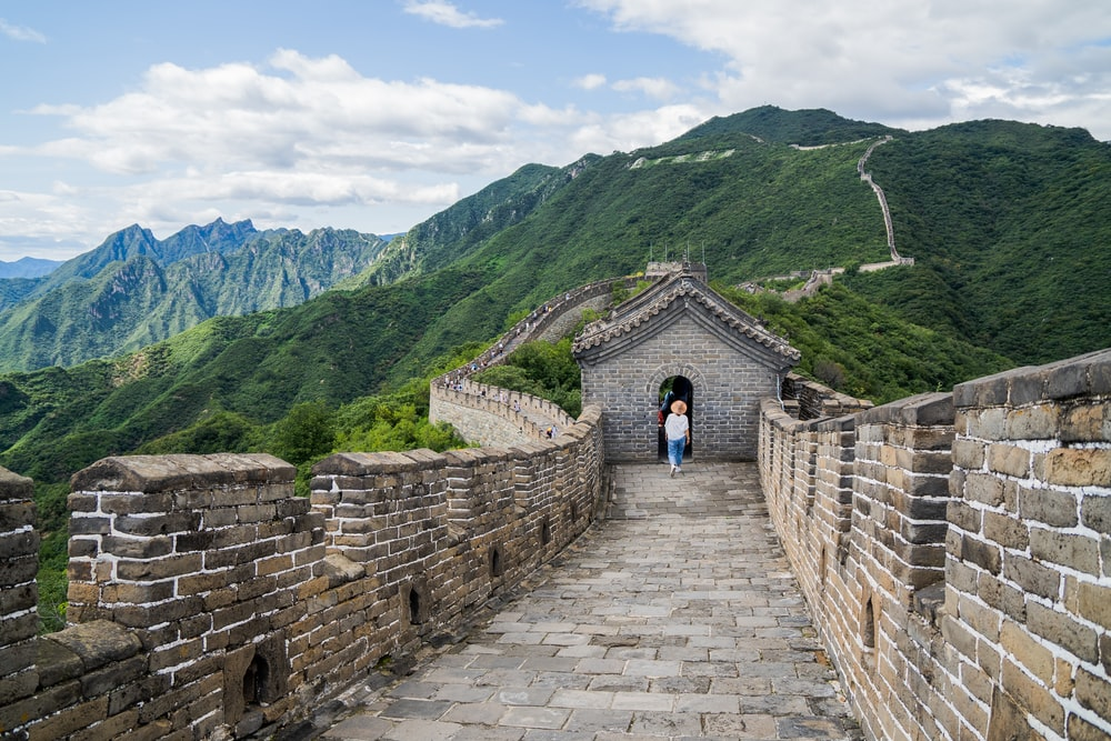 woman walking on great wall of China during daytime