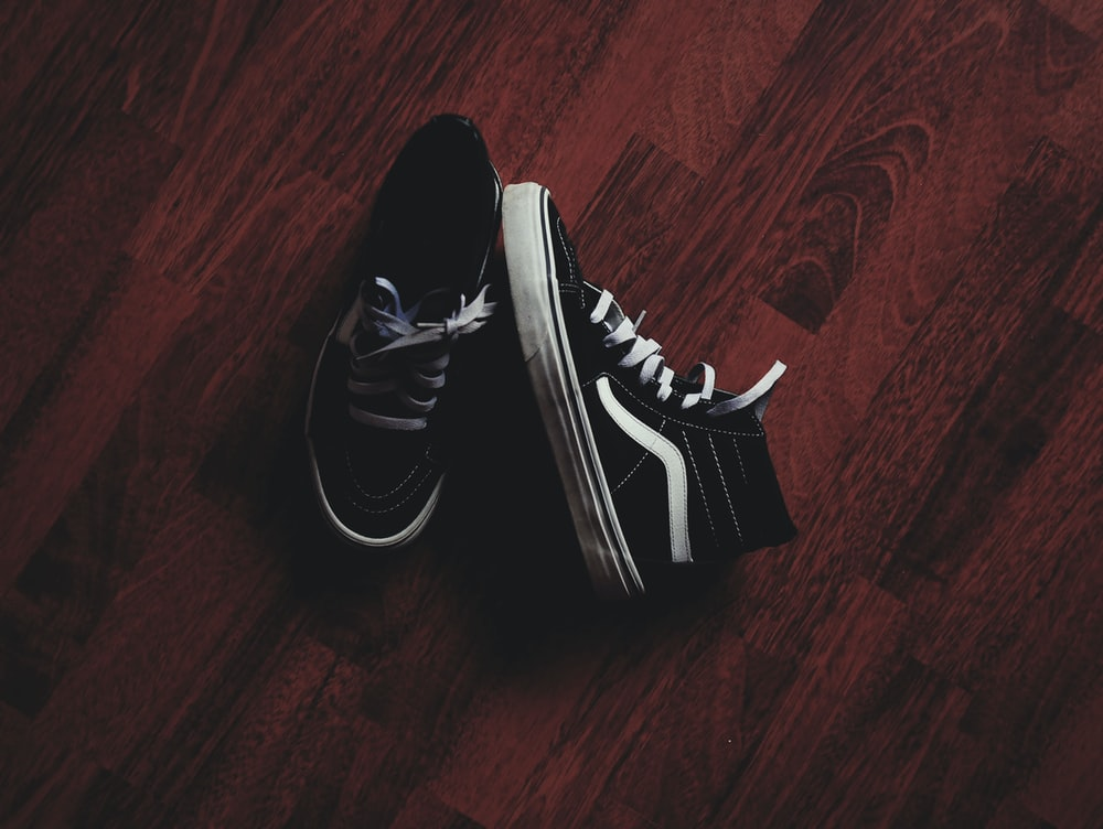 pair of black Vans high