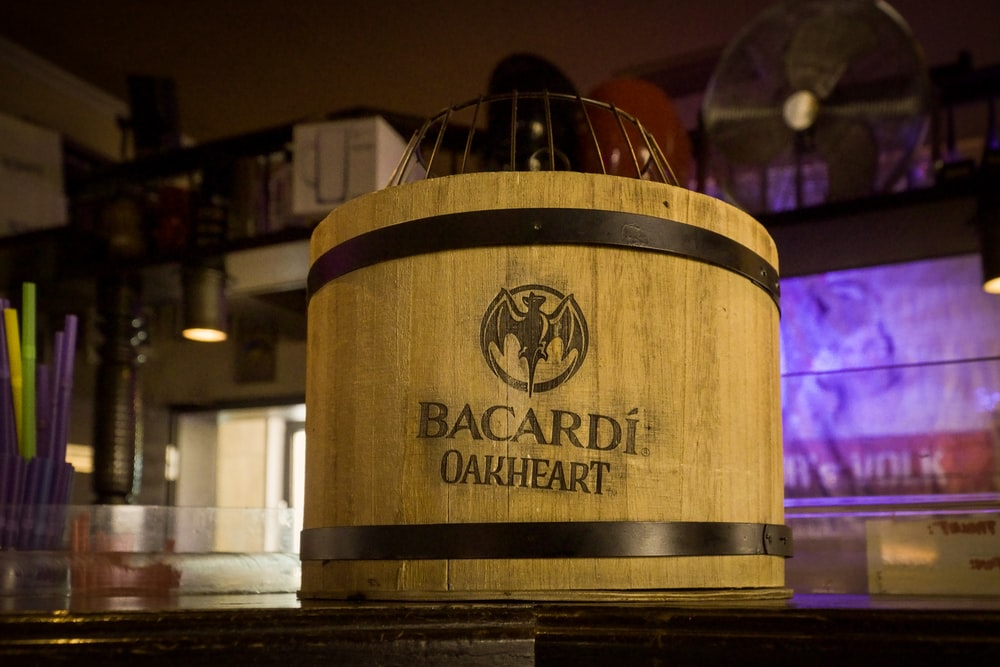 brown Bacardi ice bucket on black surfcae