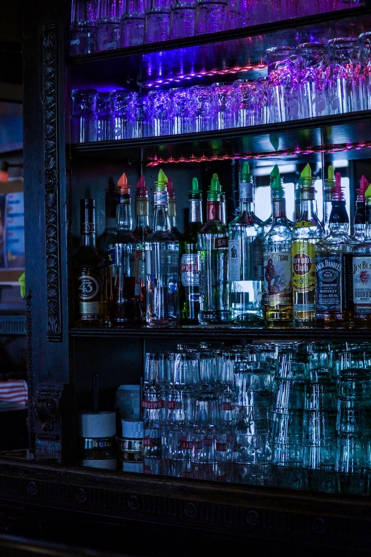 clear glass bottles on rack