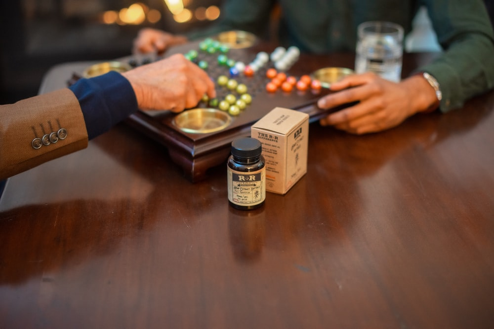 labeled bottle on wooden table