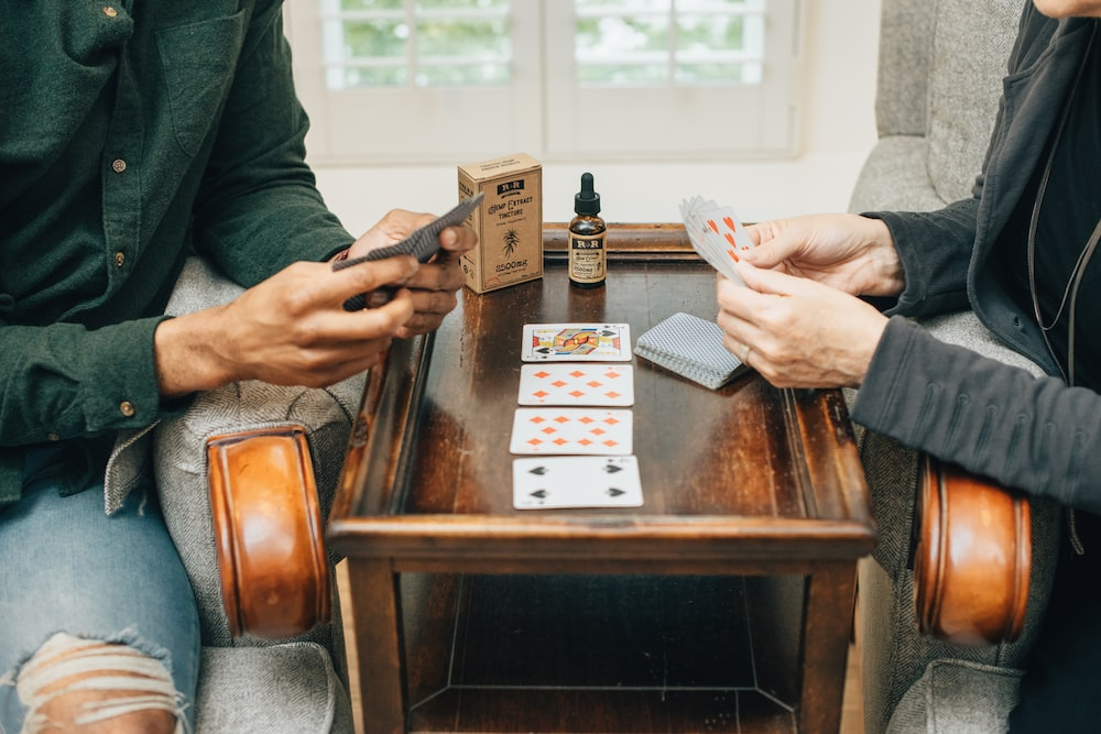 two person playing playing cards