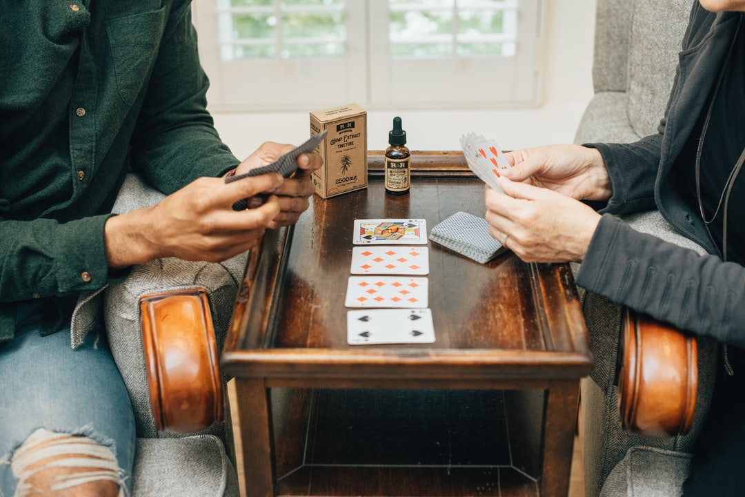 Colorado friends playing cards with hemp extract oil tincture