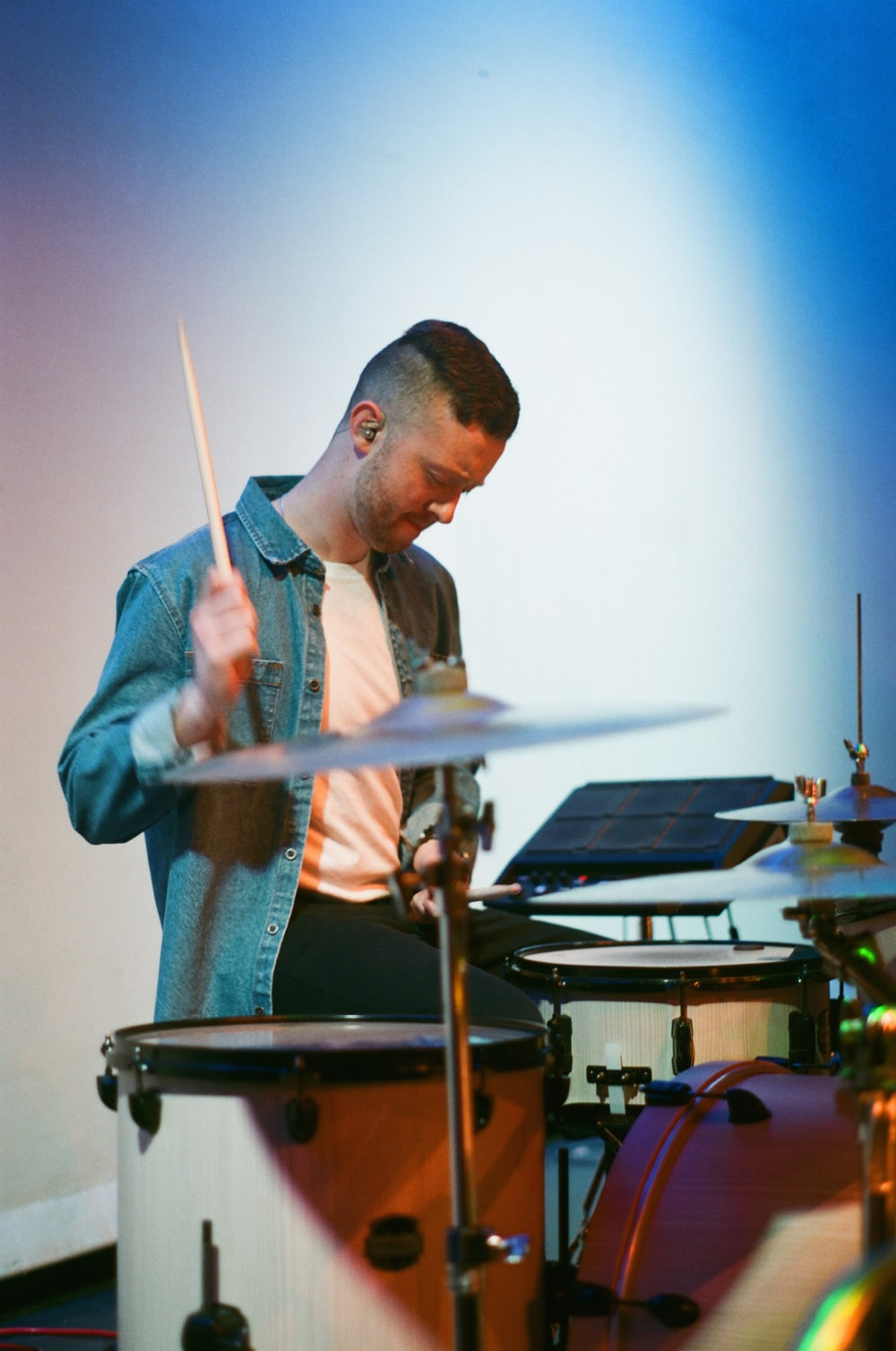 man about to strike drumstick on the drums