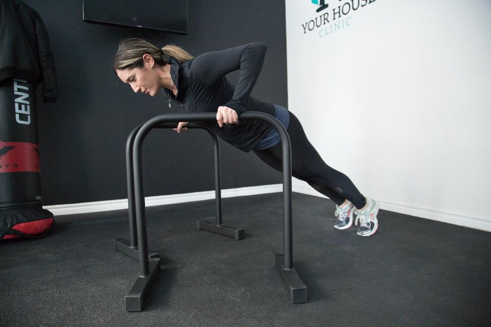 woman pushing bars