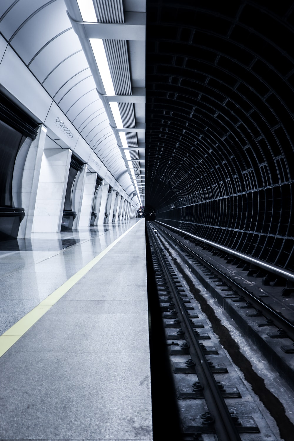 grayscale photography of train station with no people