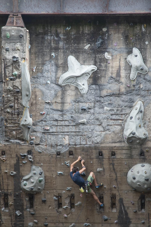 man doing wall climbing
