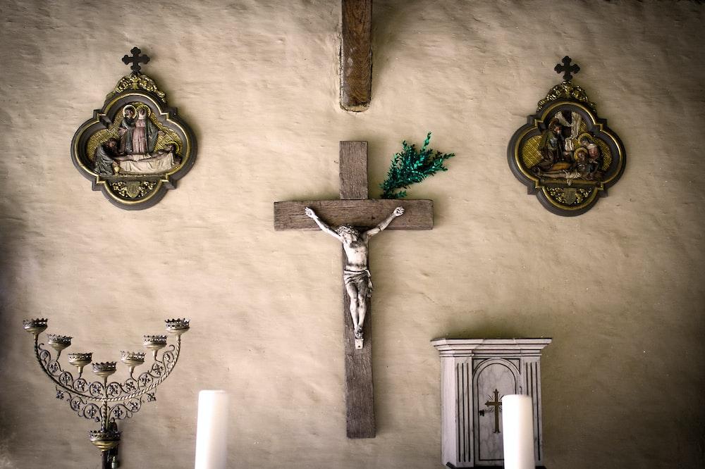brown crucifix wall decor