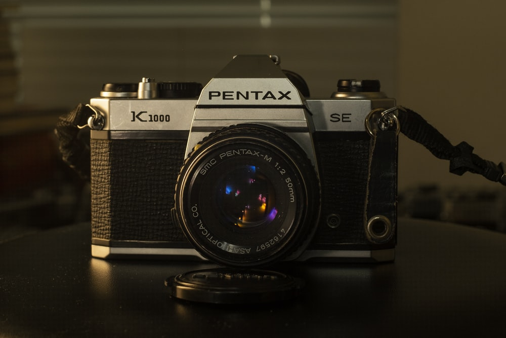 black and grey Pentax camera
