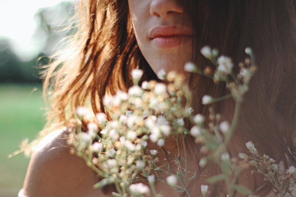 woman wears white flower